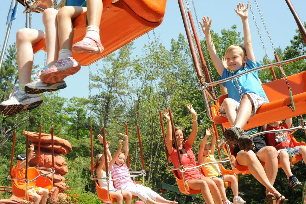 Kids riding swing ride