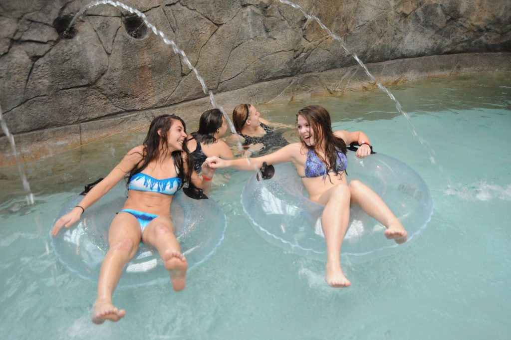 Teens floating the lazy river