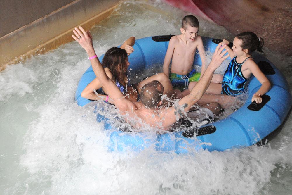 Family splashing on slide