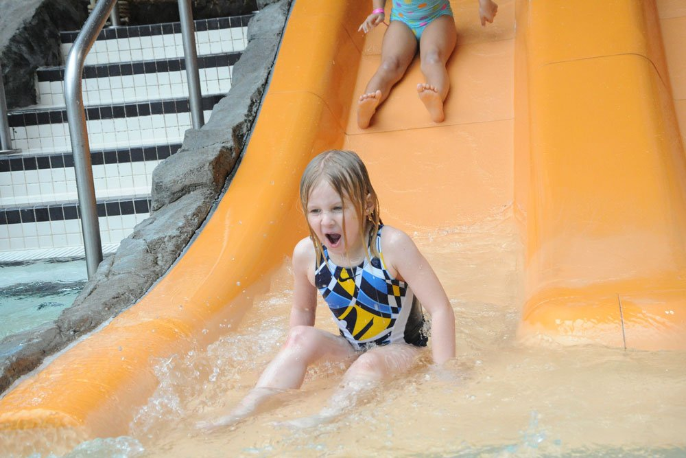 Young girl on slide