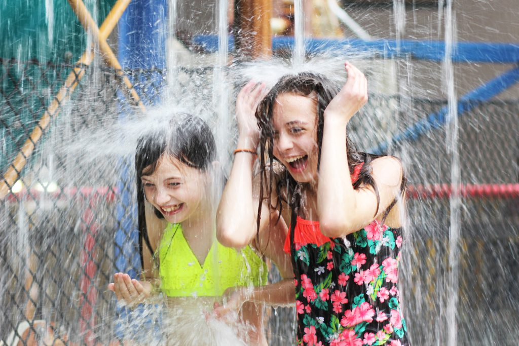 Girls splashing at indoor waterpark