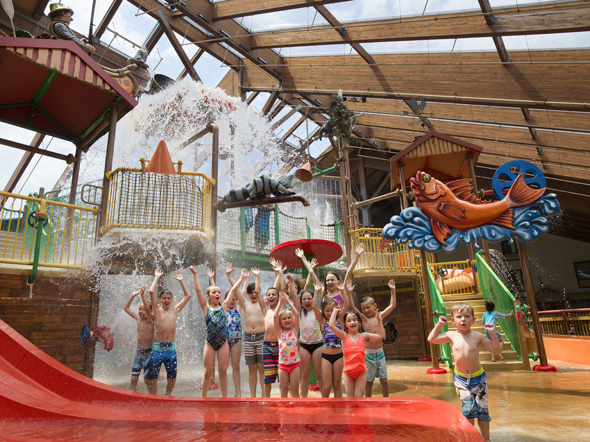 People playing at indoor waterpark