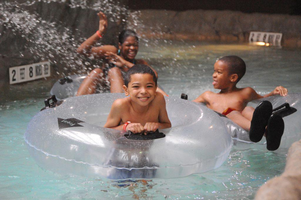 Kid floating inner tube in lazy river