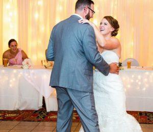 Bride and groom dancing at wedding