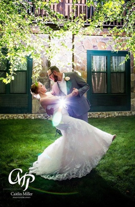 Bride & groom taking wedding photos in courtyard